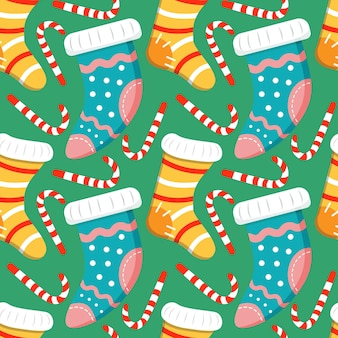 패턴과 사탕 지팡이 줄무늬 크리스마스 니트 양말과 원활한 크리스마스 배경