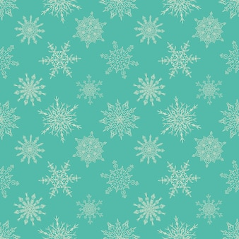 Seamless christmas green pattern with drawn snowflakes