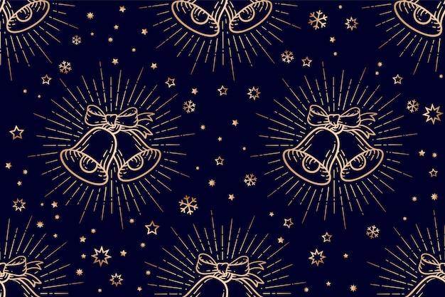 Бесшовный рождественский узор, золотые колокольчики со световыми лучами