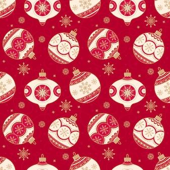 Рождественский фон с елочными шарами на красном фоне.