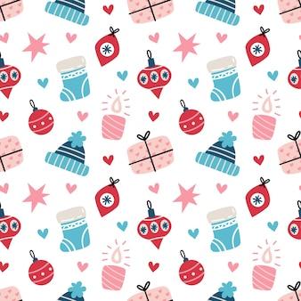 니트 모자, 양말, 선물 상자와 함께 완벽 한 크리스마스 패턴입니다.
