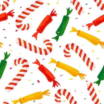甘いロリポップと分離された紙吹雪のシームレスなクリスマスのパターン