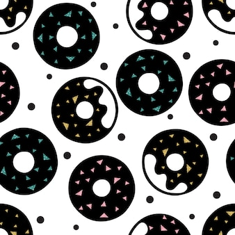 Seamless doughnuts with colorful glitter topping pattern background