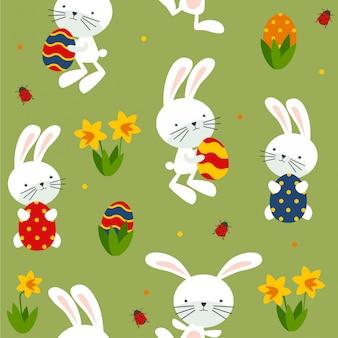 Бесшовный пасхальный образец с кроликами и яйцами.
