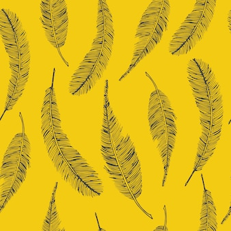 Seamless ethnic pattern with feathers on yellow