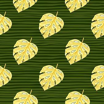 Seamless exotic jungle pattern with light yellow monstera foliage print. green dark striped background.