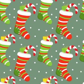 Бесшовный праздничный фон с рождеством вязаный носок и подарок