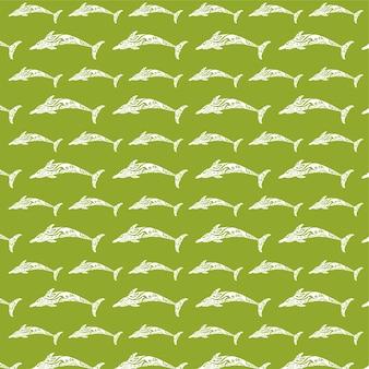 Бесшовный образец рыбы на зеленом фоне