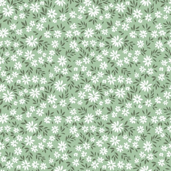 Seamless floral pattern for design small white flowers light green background floral print