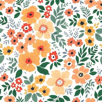 デザインのためのシームレスな花柄小さなオレンジ色の花白い背景モダンな花柄