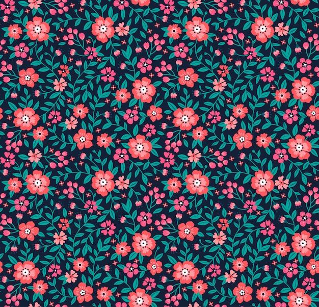 設計のためのシームレスな花柄。小さなピンクの花。
