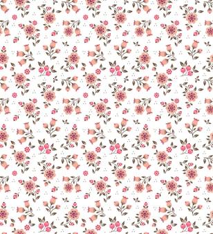 設計のためのシームレスな花柄。小さなバラ色の花。