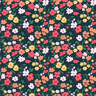 のためのシームレスな花柄。小さな色とりどりの花。緑の背景。モダンな花柄。