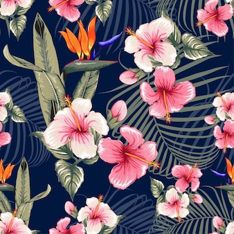 Seamless floral pattern hibiscus flowers dark blue background.