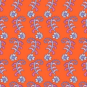オレンジ色の背景にシームレスな花柄ペイズリーモチーフ