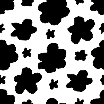 Seamless floral vector pattern with flowers. hand drawn black paint illustration with abstract floral motif.