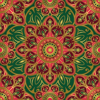 Seamless green and pink pattern with mandalas.