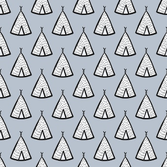 Seamless hand drawn doodle pattern with wigwam silhouettes. little white teepees on soft blue background.