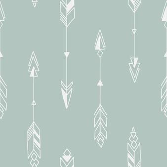 矢印の付いたシームレスな手描きの幾何学的な部族パターン。
