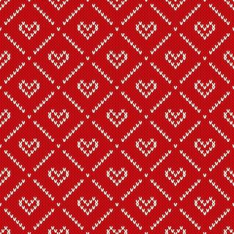 心でシームレスなニットパターン。バレンタインデーの背景