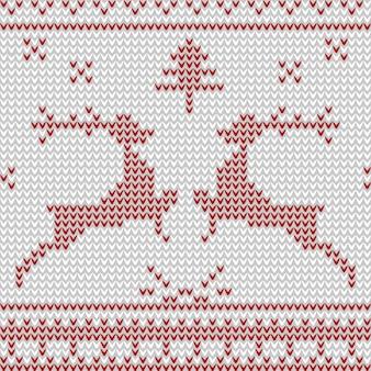 白地に赤の鹿とのシームレスなニットパターン