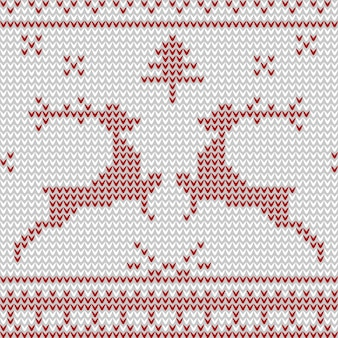Seamless knitted pattern with red deers on white