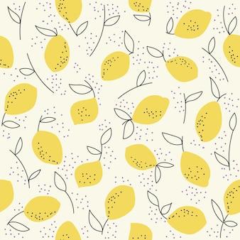 Бесшовный узор из лимонов и листьев на белом фоне. рисование руки.