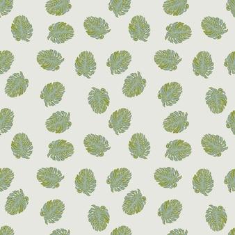 녹색 몬스테라 잎 모양이 있는 매끄러운 자연 이국적인 패턴입니다. 회색 파스텔 배경입니다.
