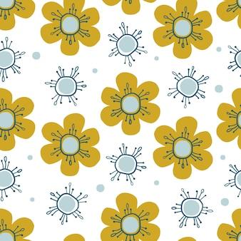 手でシームレスな自然パターン背景を描く黄色と青の花