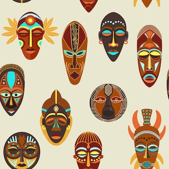 Seamless pattern of african ethnic tribal ritual masks of different shapes.