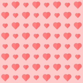 Бесшовные фон украшен сердцем в розовом цвете.