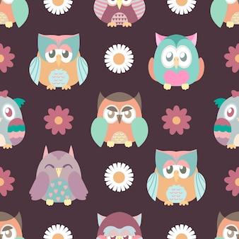フクロウとシームレスなパターンの背景