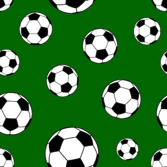 Seamless pattern of big soccer balls on green background