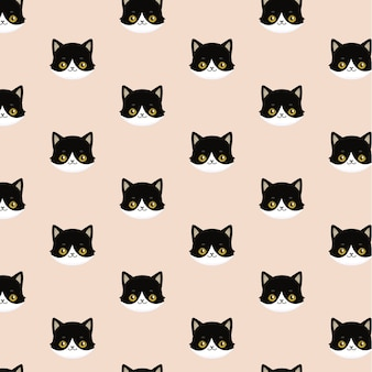 Seamless pattern of black heads of cats.
