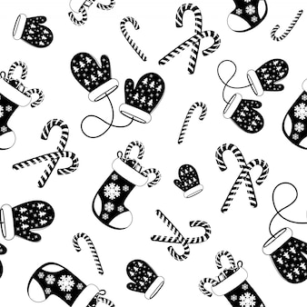 Seamless pattern black and white of woolen blue mitten and christmas socks.