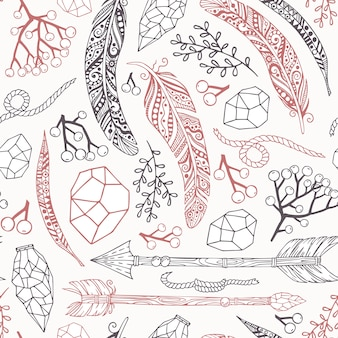 Seamless pattern in boho style with arrows of feathers, plants, stones and rope.
