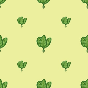 Seamless pattern bunch spinach salad on pastel yellow background. modern ornament with lettuce.