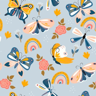 Seamless pattern of butterflies and rainbows in boho style. vector graphics.