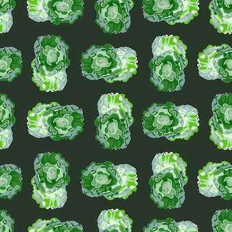 Бесшовный узор баттерхед салат на темном фоне. абстрактный орнамент с салатом.