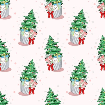 カップケーキ漫画のシームレスなパターンの猫とクリスマスツリー