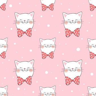 Seamless pattern cat with bow tie in snow.