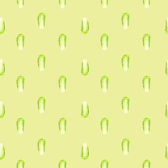 Бесшовный фон китайская капуста на бежевом фоне. простой орнамент с салатом.