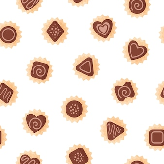 Seamless pattern of chocolates of various shapes with icing for valentine's day.