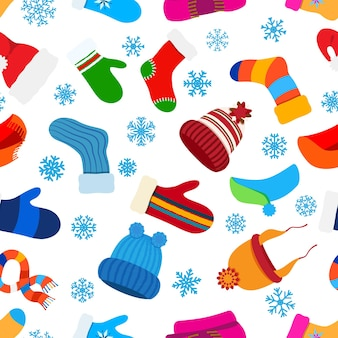 Seamless pattern of christmas warm winter clothes in flat style on white background