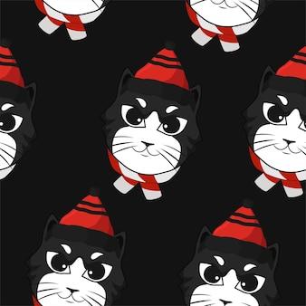 頭の猫とのシームレスなパターンのクリスマス