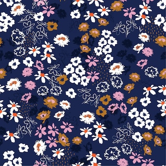 Seamless pattern in colorful small pretty flowers. liberty style blooming meadow florals