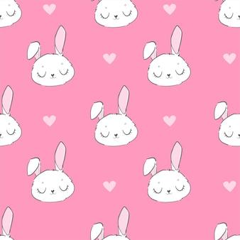 Бесшовный фон милый кролик и розовые цветы на розовом фоне