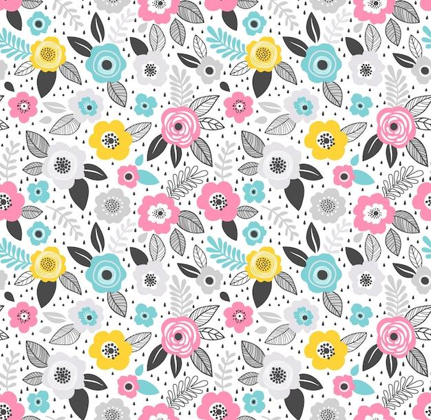 シームレスパターン。小さな花でかわいい柄。小さな青、ピンク、黄色の花。白い 。頭が変なモダンな花の背景。