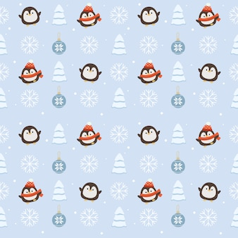 Seamless pattern of cute penguin with christmas ball and christmas tree and snowflakes on blue