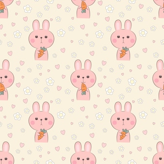Seamless pattern cute rabbit hold a carrot.